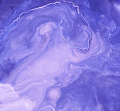 Purple swirls of paint. Can of cream paint that has separated and looks like swirls of purple Stock Image