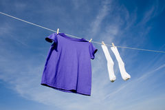 Purple T-Shirt and Socks on Clothesline royalty free stock photography