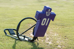 Purple tackling dummy sled. In a grass field Stock Photos