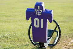 Purple tackling sled facing forward. Front view of purple tackling sled with grass background Stock Photo