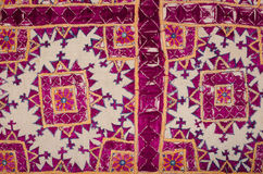 Purple tapestry with geometric motives Royalty Free Stock Photo