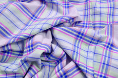 Purple tartan pattern on crumpled fabric. Royalty Free Stock Photo