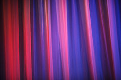 Purple theater curtain. Abstract purple background. Closeup of a theater curtain. Curtains theater lit by bright light of spotlights Royalty Free Stock Photo