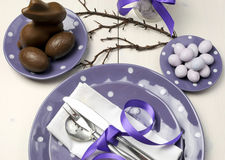 Purple theme Easter dinner, breakfast or brunch table setting, aerial view. Stock Image