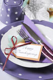 Purple theme Thanksgiving place setting closeup. Royalty Free Stock Photos