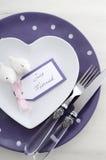 Purple theme wedding table place setting. stock photography