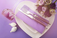 Purple theme wedding table place setting. Stock Images