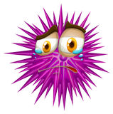 Purple thorn ball with crying face Stock Photos