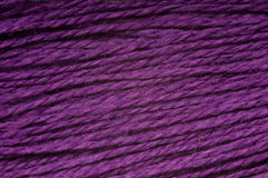 Purple threads. Horizontal rows of threads in purple Stock Image