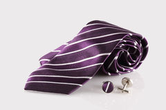 Purple tie with cuff links. On white background stock photo