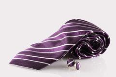 Purple tie with cuff links. On white background Stock Image
