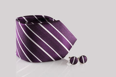 Purple tie with cuff links. On white background royalty free stock image