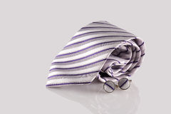 Purple tie with cuff links. On white background stock photography
