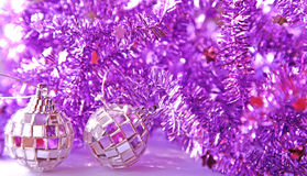 Purple tinsel Royalty Free Stock Images