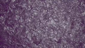 Purple shimmer water. Purple tinted water shimmers as it passes across the screen.  glitter sheen shine shine textures movement passage backgrounds ila Schimmer stock video