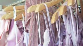 Purple tone dress. Purple tone womem dress hanging on hangers Stock Photo