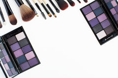purple tone eye shadows and makeup brushes set Stock Photos
