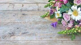 Purple tone Flower bouquet. On wooden table Stock Images