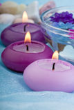 Purple toned candles and flowers (1) Royalty Free Stock Photo