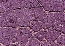 purple toned damaged asphalt road texture. Stock Image