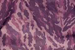 Purple toned military camouflage uniform pattern. Abstract background and texture for design Royalty Free Stock Photography