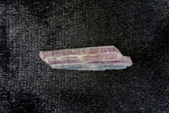 Purple Tourmaline. A purple tourmaline crystal spire with a blue looking portion Stock Images
