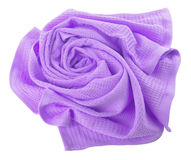 Purple towel in flower shape. Purple waffle towel folded in the shape of a rose on a white background Stock Photos