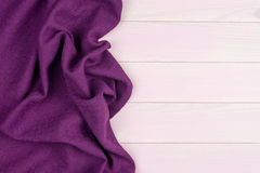 Purple towel over wooden table Stock Photos