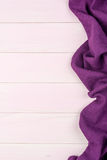 Purple towel over wooden table Royalty Free Stock Images