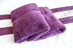 Purple towels on the bed rooms Stock Images