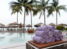 Purple towels pool side Stock Image