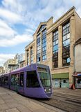 Purple tram in front of art deco building taken in Reims stock photos