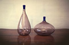 Purple transparent Murano vases. Couple purple Murano glass vase in minimalistic 1950 style royalty free stock images