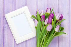 Purple tulip bouquet and blank photo frame Stock Image