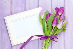 Purple tulip bouquet and blank photo frame Royalty Free Stock Photography