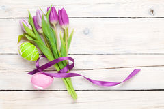 Purple tulip bouquet and easter eggs Stock Photos