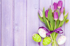 Purple tulip bouquet and easter eggs Stock Image