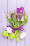 Purple tulip bouquet and easter eggs Royalty Free Stock Images