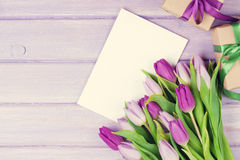 Purple tulip bouquet, greeting card and gifts Stock Image