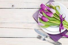 Purple tulip bouquet over plate Stock Photo