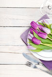 Purple tulip bouquet over plate Stock Images