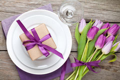 Purple tulip bouquet and plate with gift box Stock Image