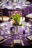 Purple tulips centerpiece at a formal dinner. Purple tulips centerpiece and purple tablecloths at a formal dinner Stock Photos