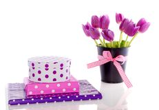 Purple tulips and gifts Royalty Free Stock Photo
