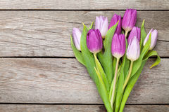 Purple tulips over wooden table Royalty Free Stock Photo
