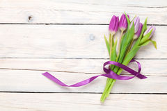 Purple tulips over wooden table Stock Photo