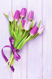 Purple tulips over wooden table Stock Photography