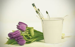 Purple tulips and paintbushes Stock Photo