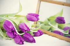Purple tulips - retro styled photo Royalty Free Stock Photography