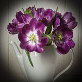 Purple tulips in vase. Old style Royalty Free Stock Photo